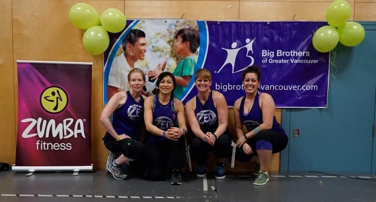 Four women wearing exercise clothing