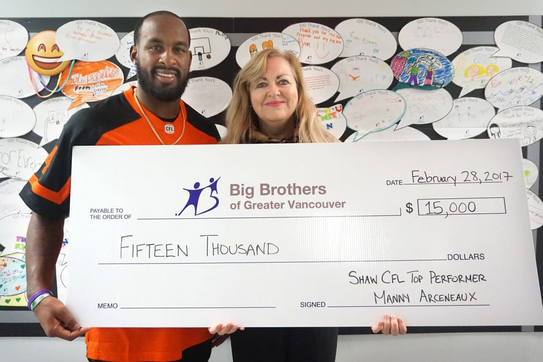 Manny Arceneaux presents Shaw donation to Big Brothers of Greater Vancouver's executive director Valerie Lambert